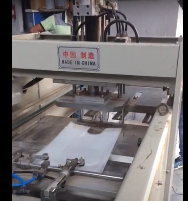 Plastic Bag Punching Machine